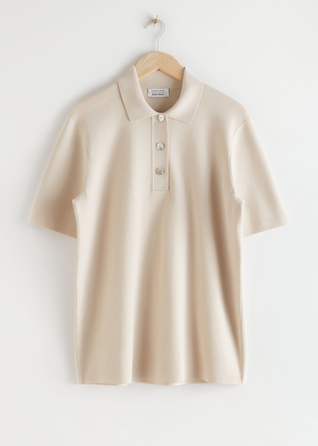 Front image of Stories oversized ribbed knit polo shirt in beige