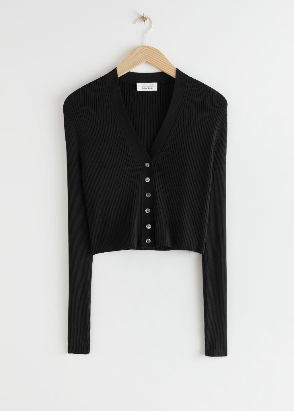 StillLife Front Image of Stories Cropped Ribbed Cardigan in Black