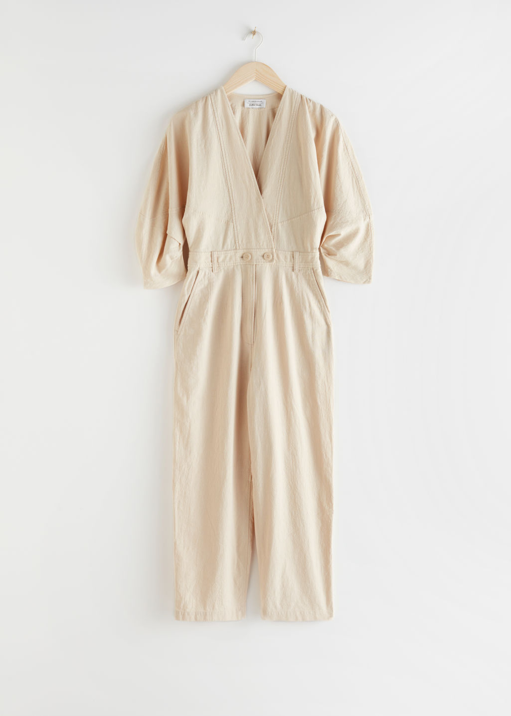 StillLife Front Image of Stories Asymmetrical Linen Blend Jumpsuit in Beige