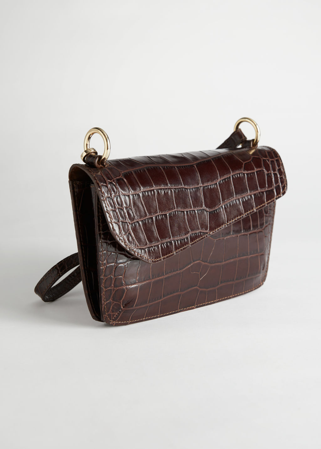 StillLife Front Image of Stories Asymmetric Flap Croc Shoulder Bag in Beige