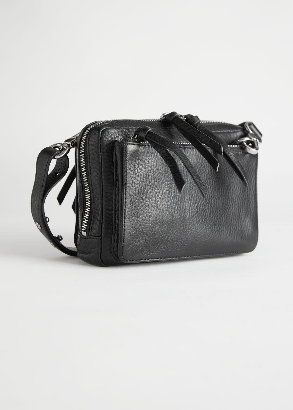 StillLife Front Image of Stories Grained Leather Crossbody Bag in Black