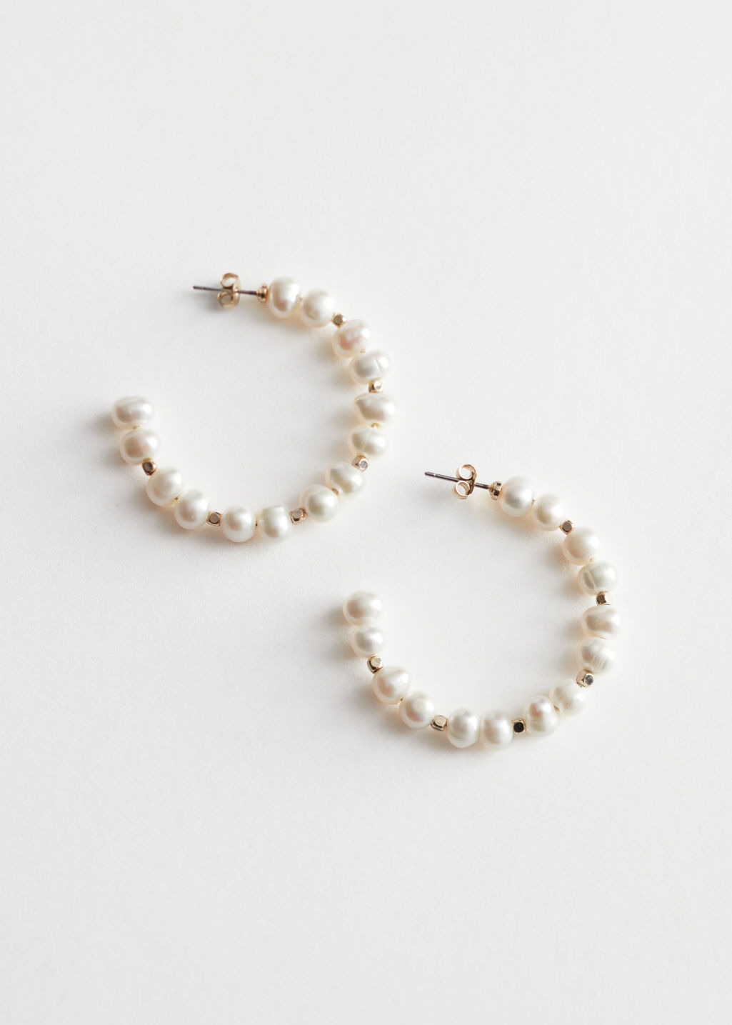 StillLife Front Image of Stories Organic Pearl Open Hoop Earrings in White