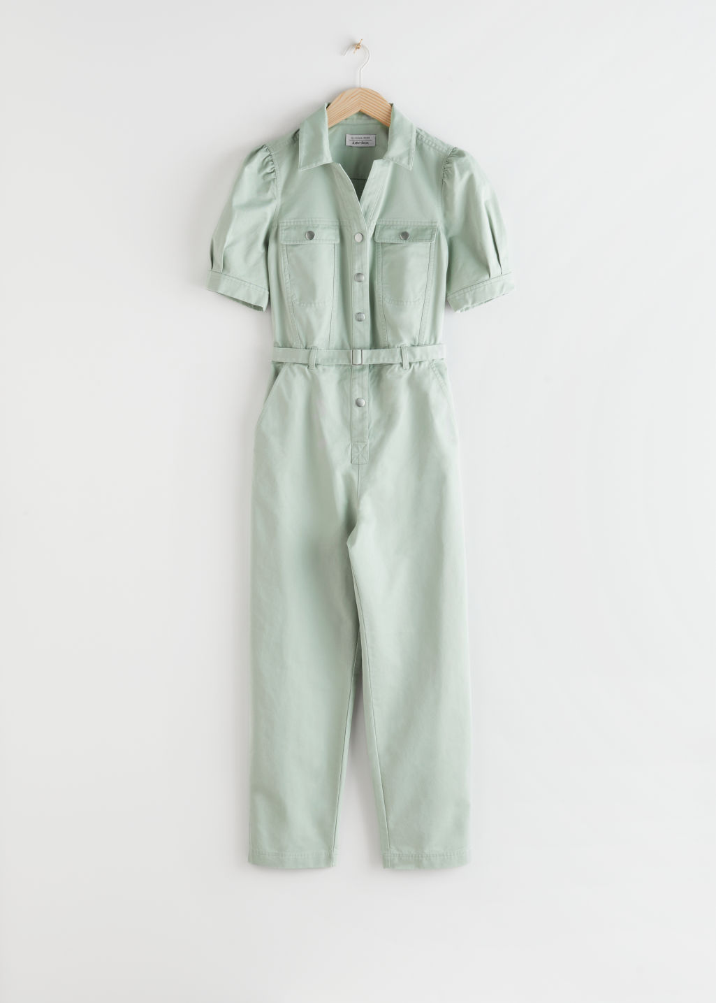 StillLife Front Image of Stories Organic Cotton Denim Jumpsuit in Green
