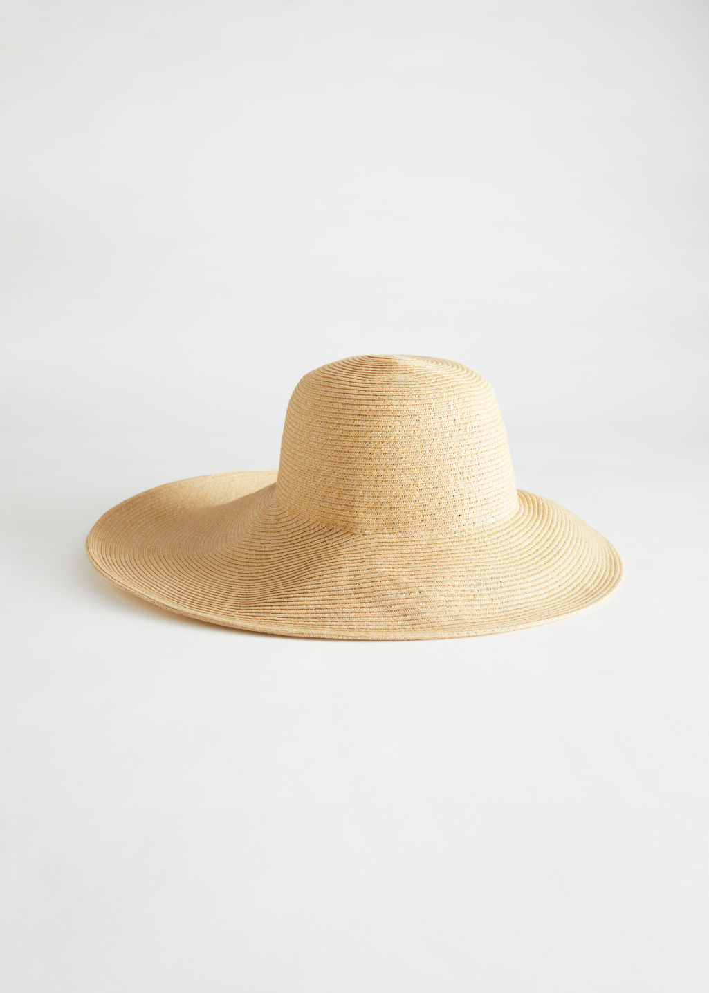StillLife Front Image of Stories Wide Brim Straw Ribbon Hat in Beige