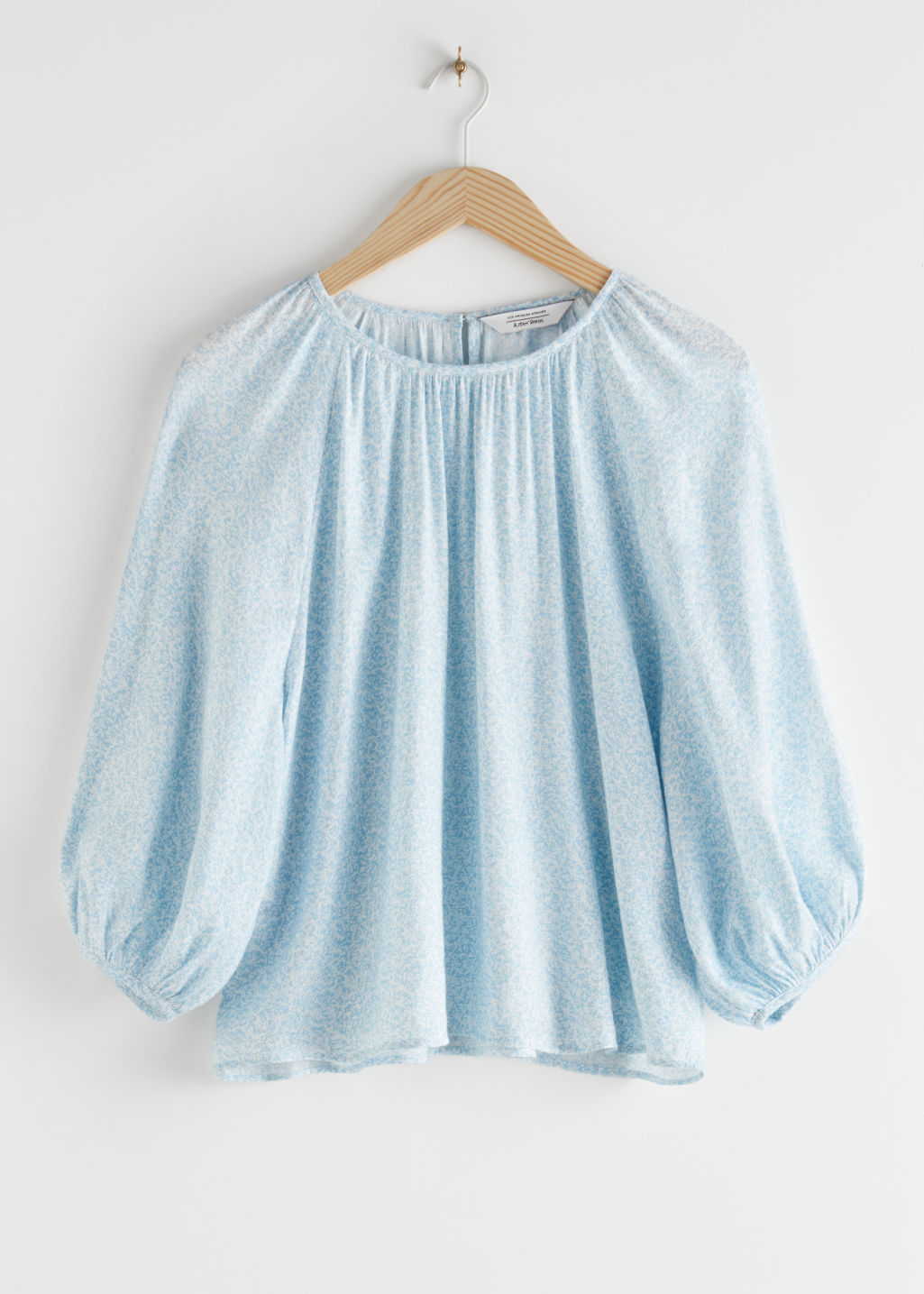 StillLife Front Image of Stories Voluminous Puff Sleeve Crepe Top in Blue