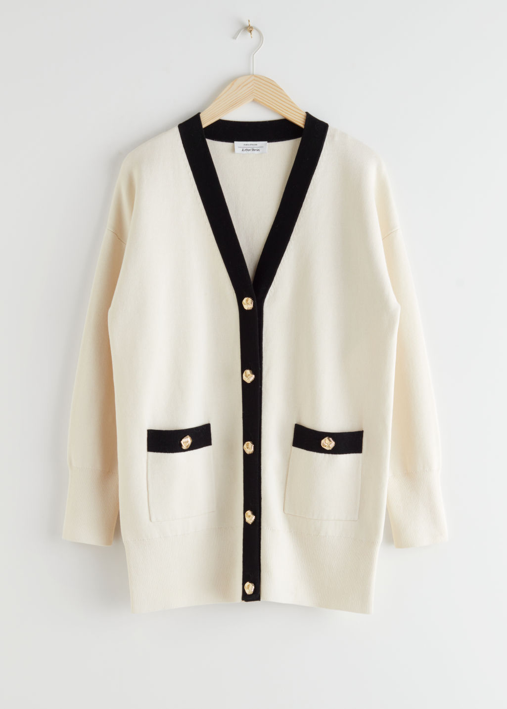 StillLife Front Image of Stories Oversized Gold Button Cardigan in White