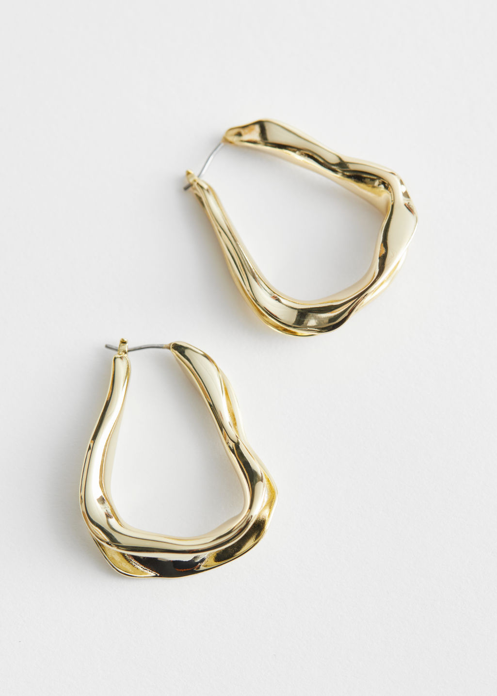 StillLife Front Image of Stories Organic Oval Hoop Earrings in Gold