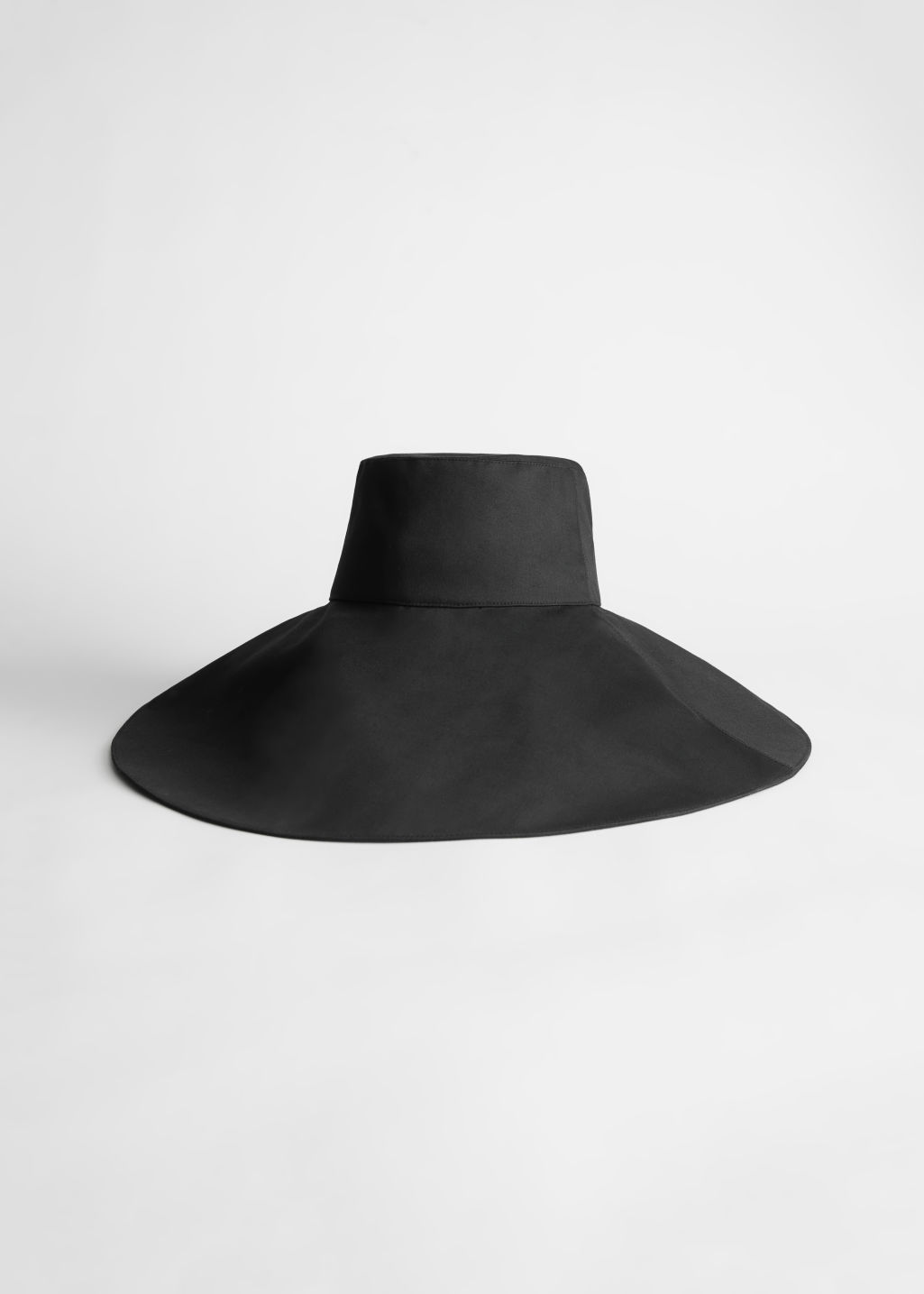 StillLife Front Image of Stories Floppy Ribbon Bucket Hat in Black