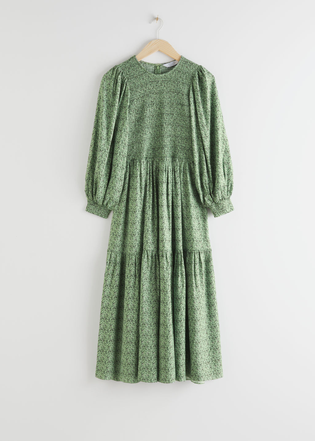 Front image of Stories smocked abstract print maxi dress in green