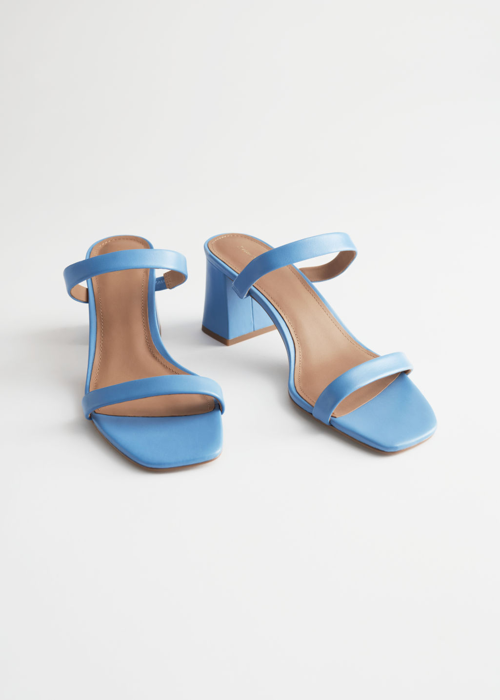 StillLife Front Image of Stories Duo Strap Leather Heeled Sandals in Blue