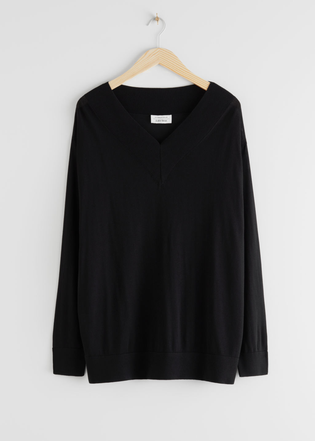 StillLife Front Image of Stories Oversized V-Neck Jumper in Black