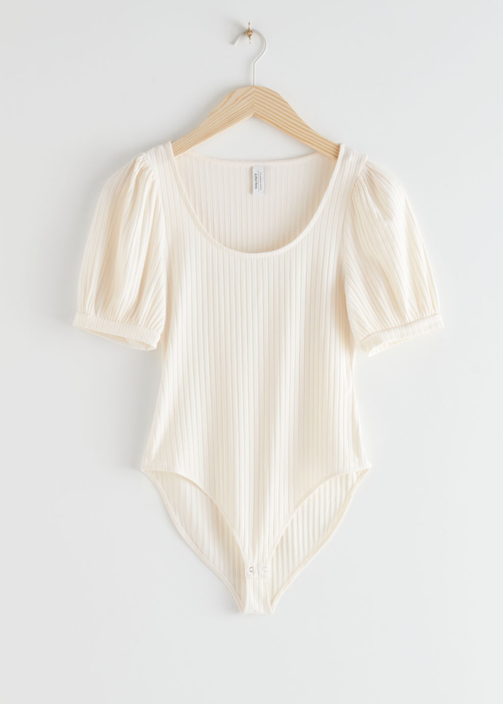 StillLife Front Image of Stories Wide Scoop Neck Ribbed Bodysuit in White