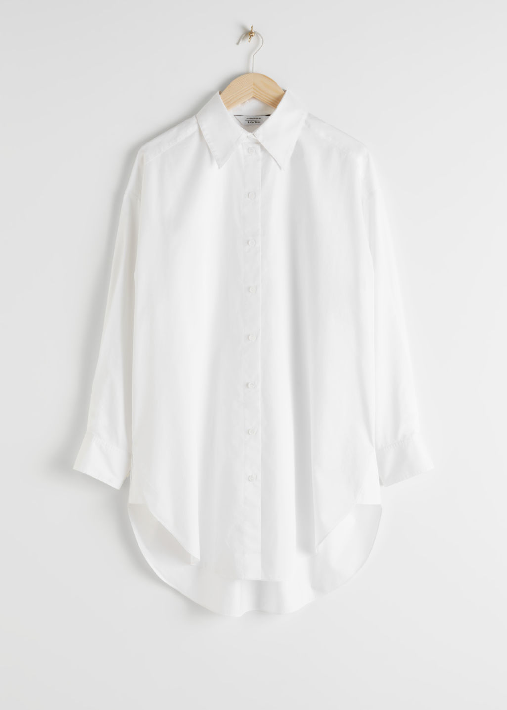 Front image of Stories classic oversized cotton shirt in white