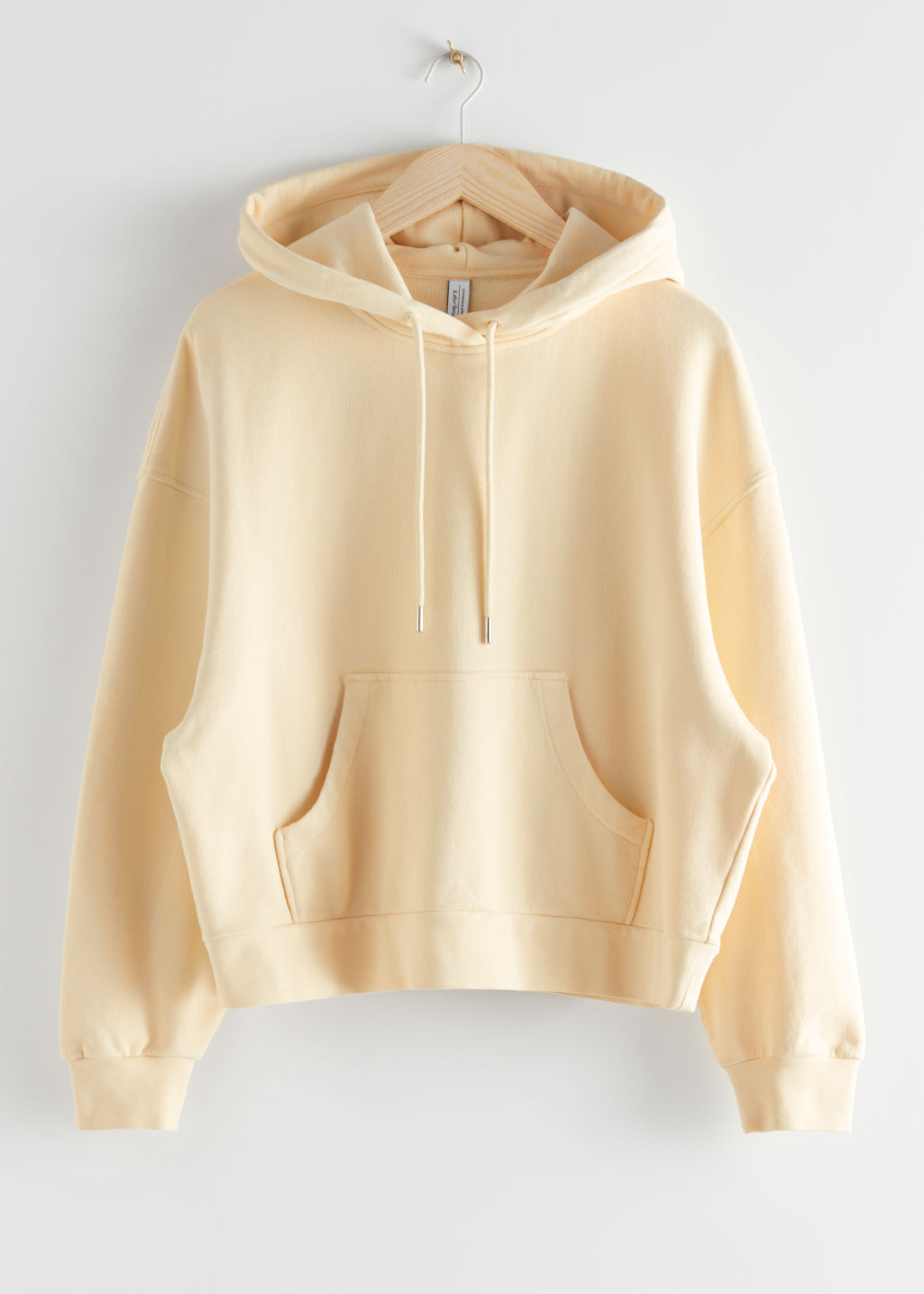 StillLife Front Image of Stories Oversized Boxy Hooded Sweatshirt in Yellow