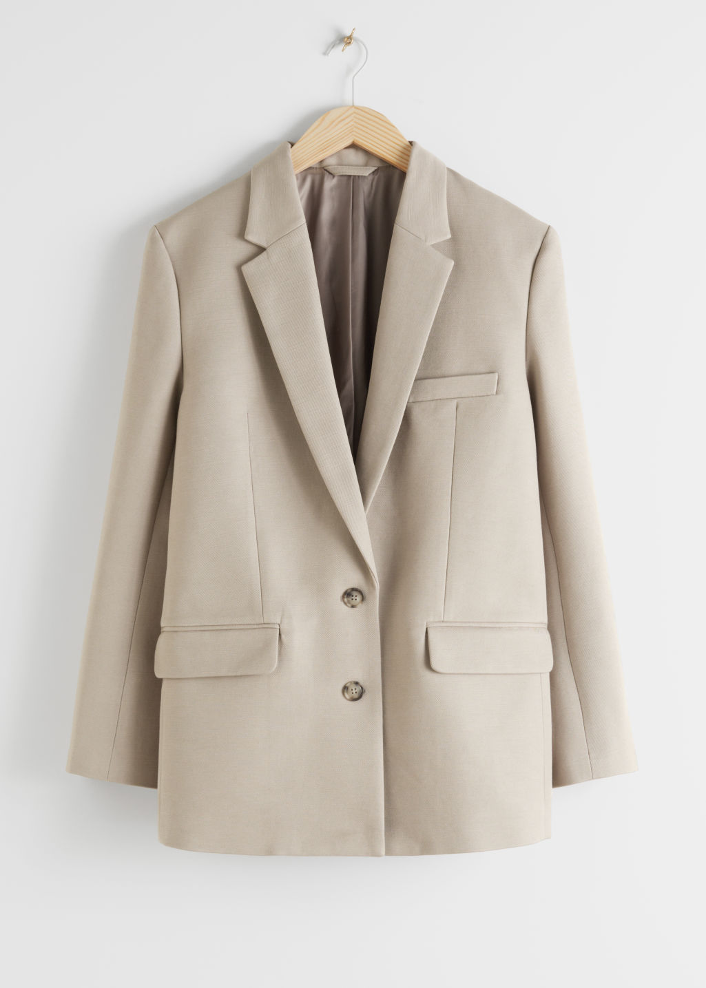 Front image of Stories tailored single breasted cotton blazer in beige