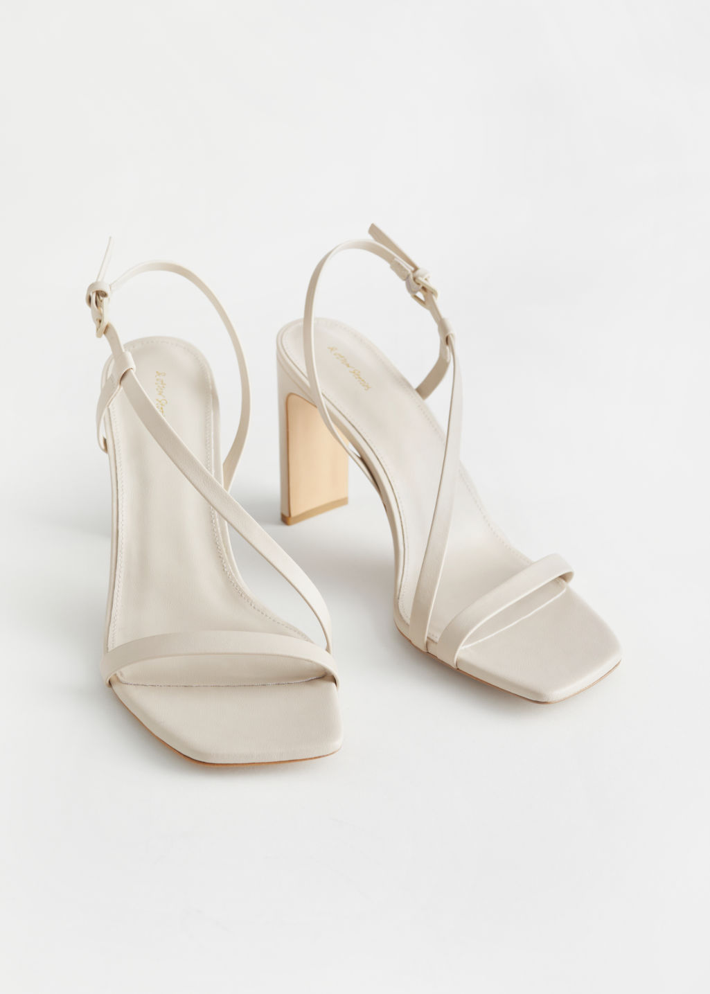 StillLife Front Image of Stories Faux Leather Heeled Sandals in White