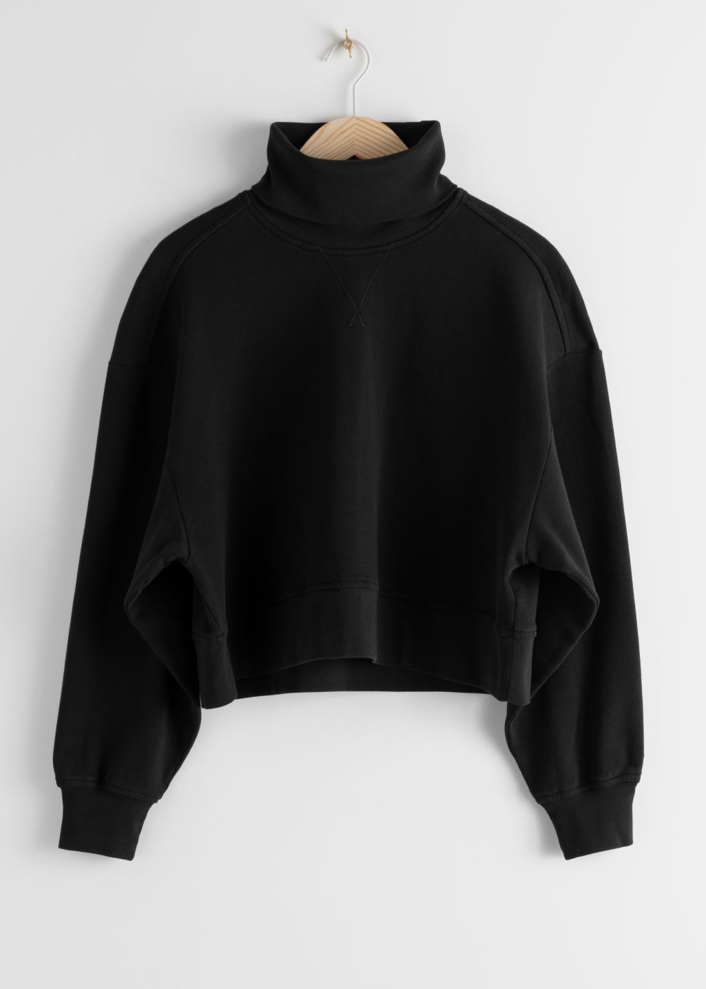 Front image of Stories organic cotton turtleneck sweater in black