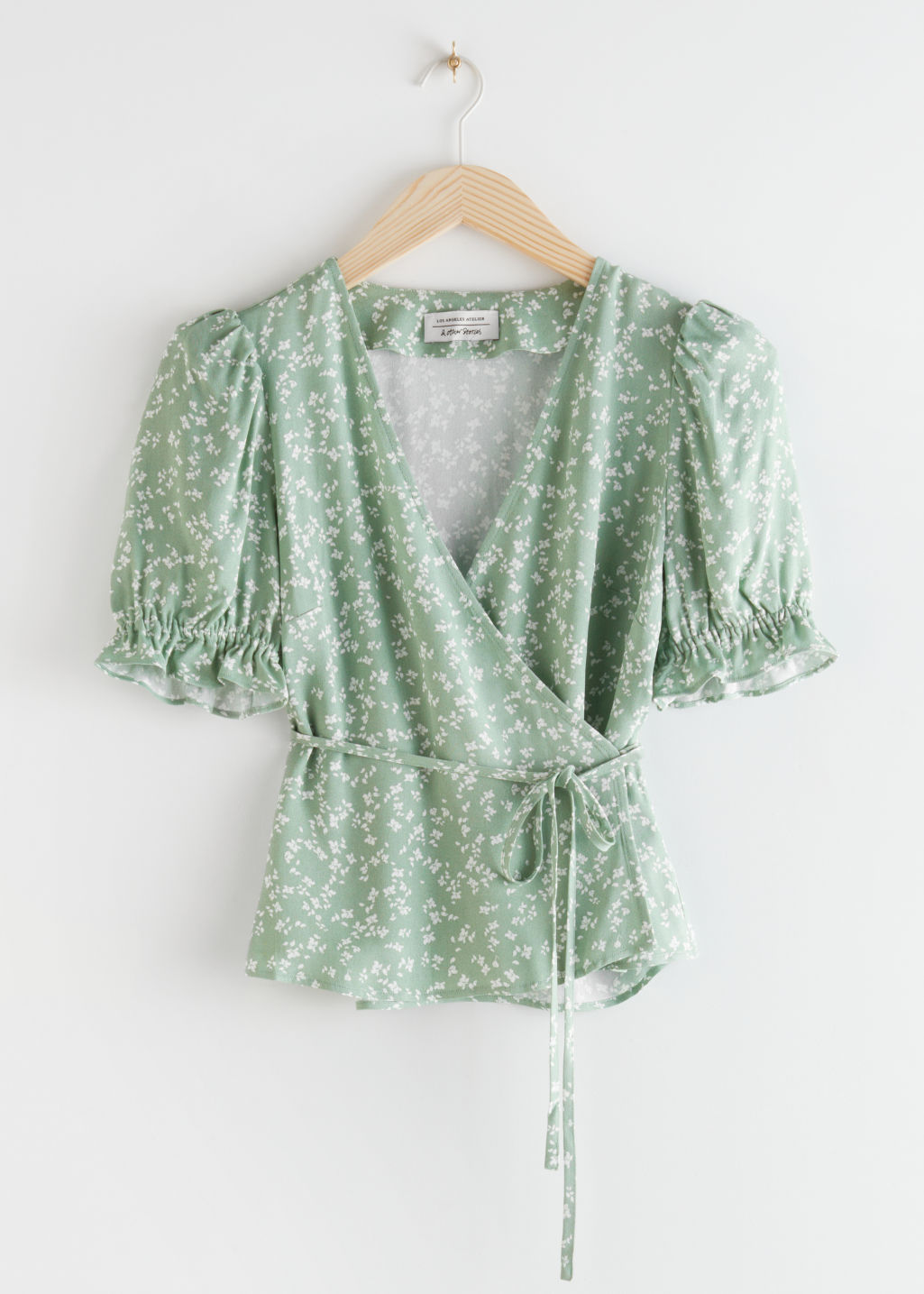 StillLife Front Image of Stories Puff Sleeve Wrap Blouse in Green