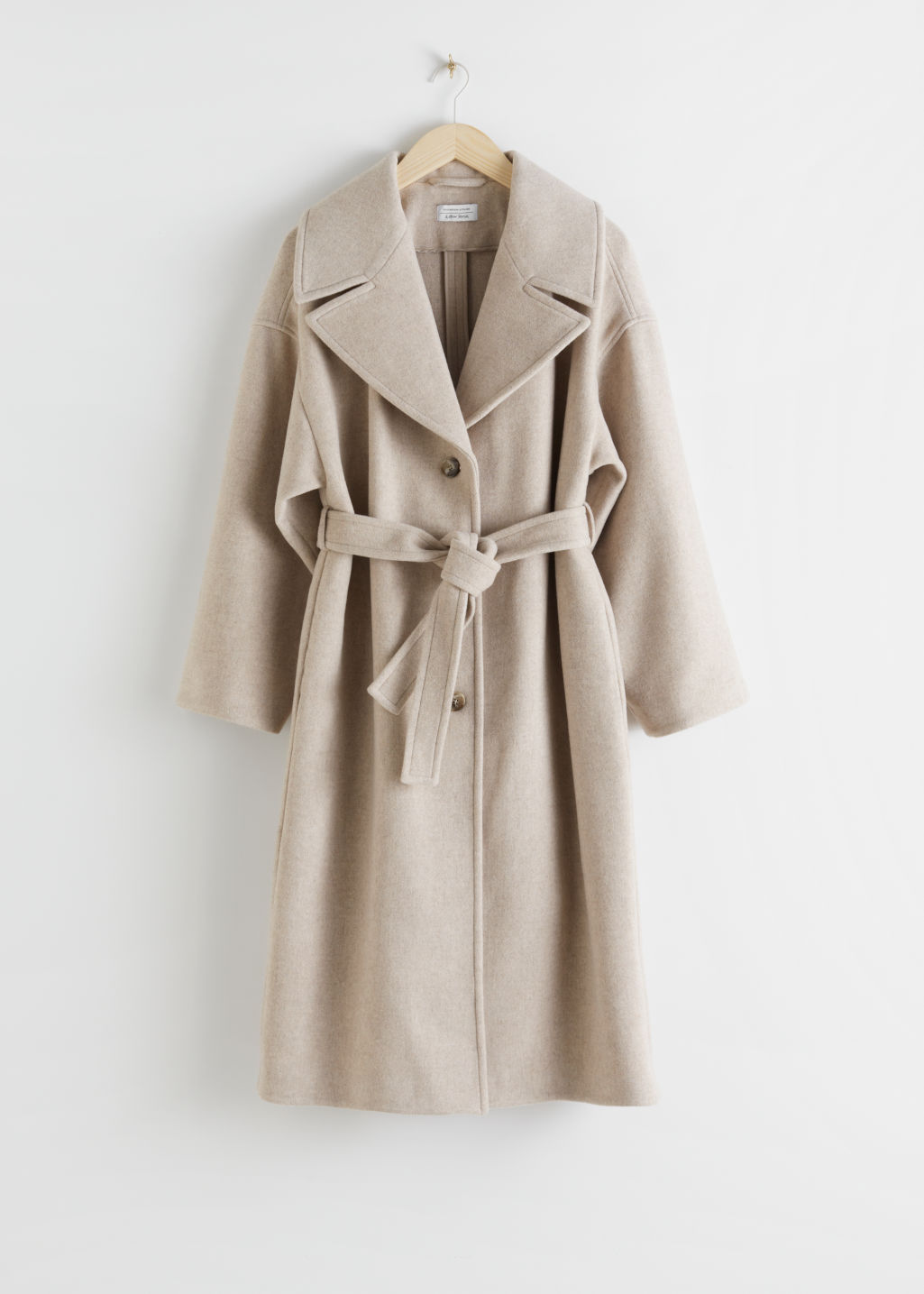 Front image of Stories oversized wool blend belted coat in white