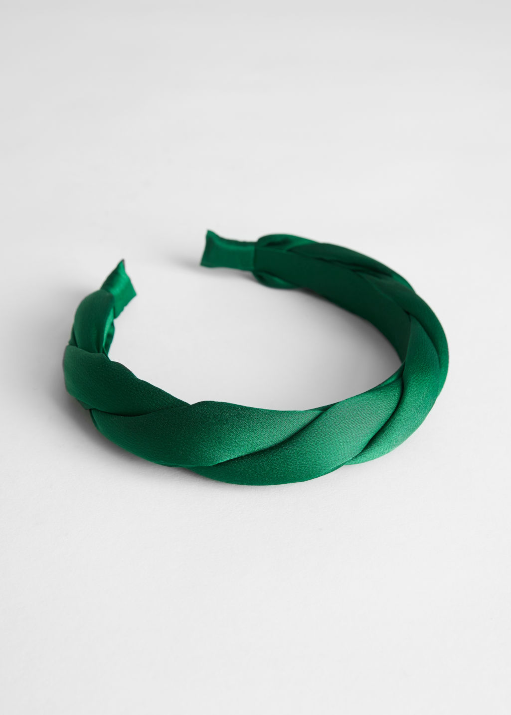 Front image of Stories braided satin alice headband in green