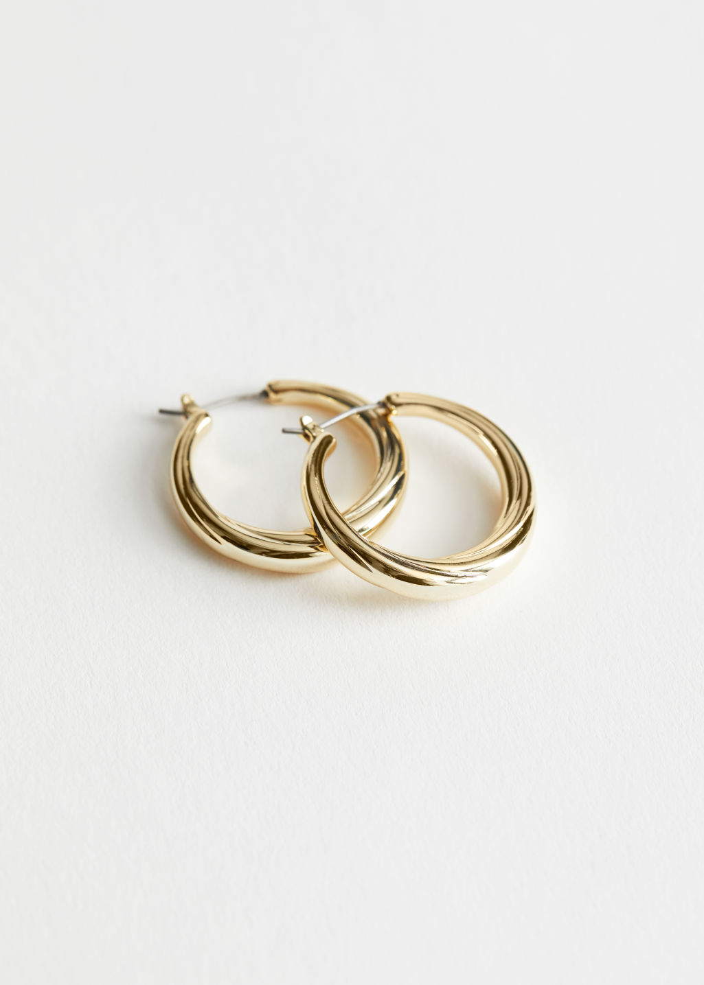 StillLife Front Image of Stories Curved Hoop Earrings in Gold