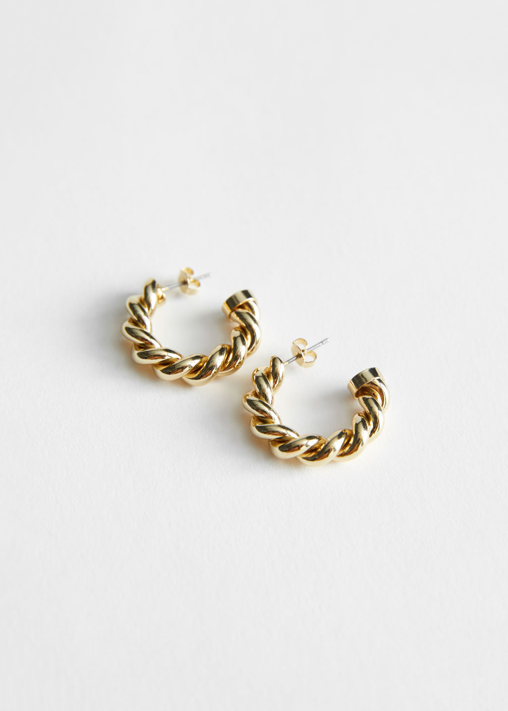 StillLife Front Image of Stories Twisted Sphere Hoop Earrings in Gold