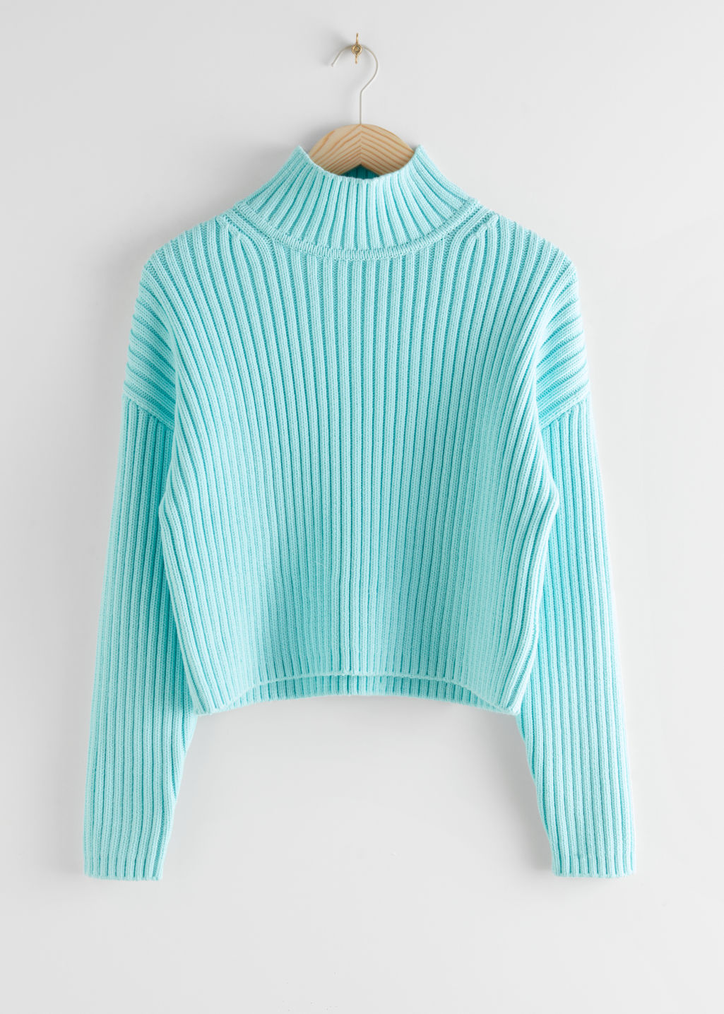 StillLife Front Image of Stories Chunky Ribbed Turtleneck Sweater in Turquoise