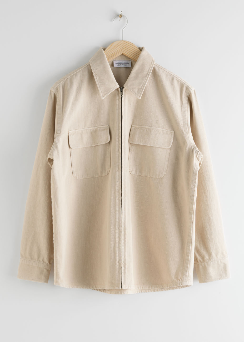 StillLife Front Image of Stories Woven Cotton Zip Up Overshirt in Beige