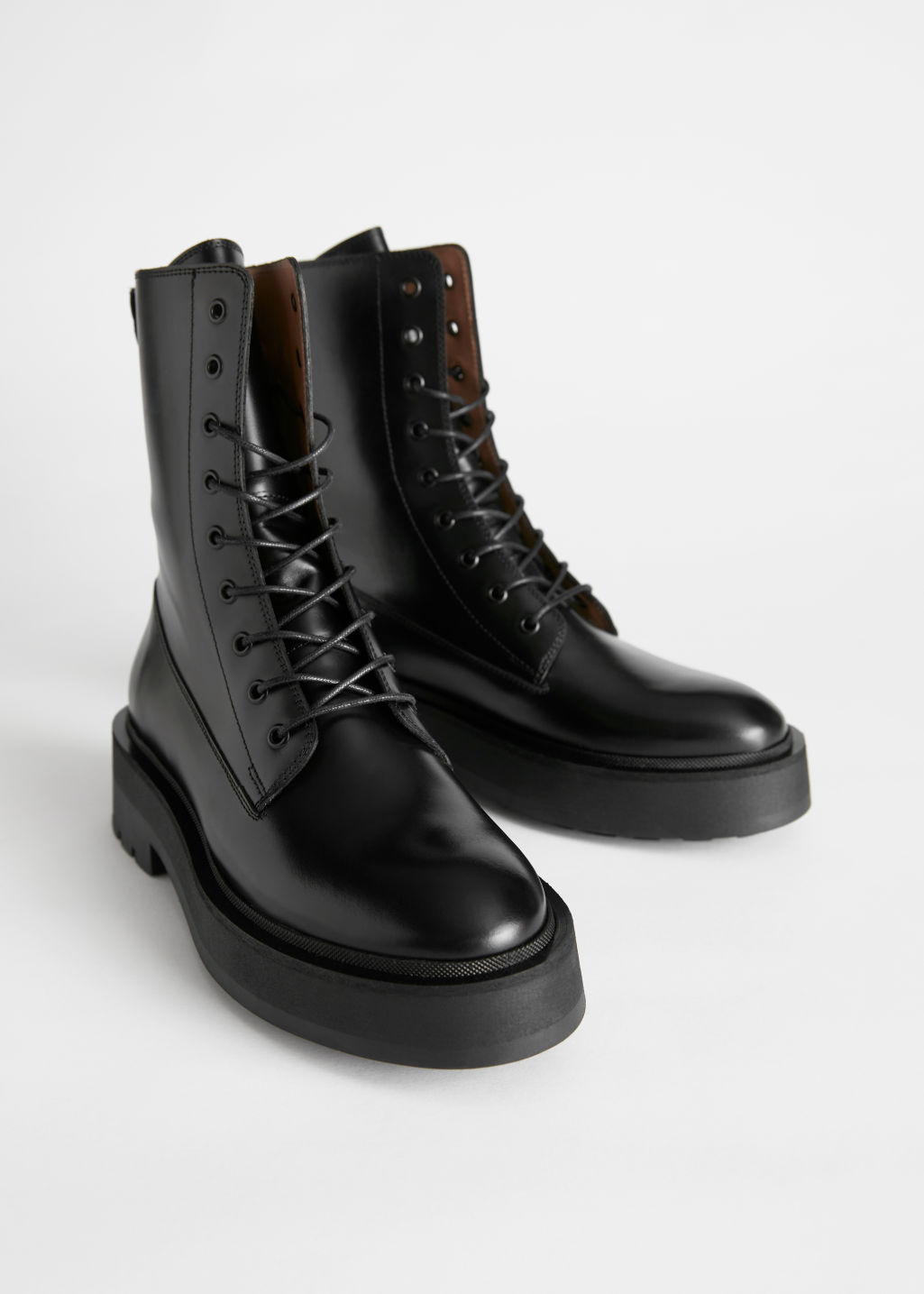 Front image of Stories chunky platform leather boots in black