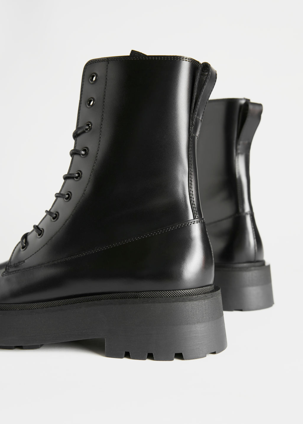 Back image of Stories chunky platform leather boots in black
