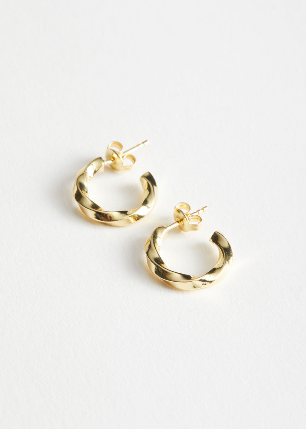 StillLife Front Image of Stories Twisted Mini Hoop Earrings in Gold