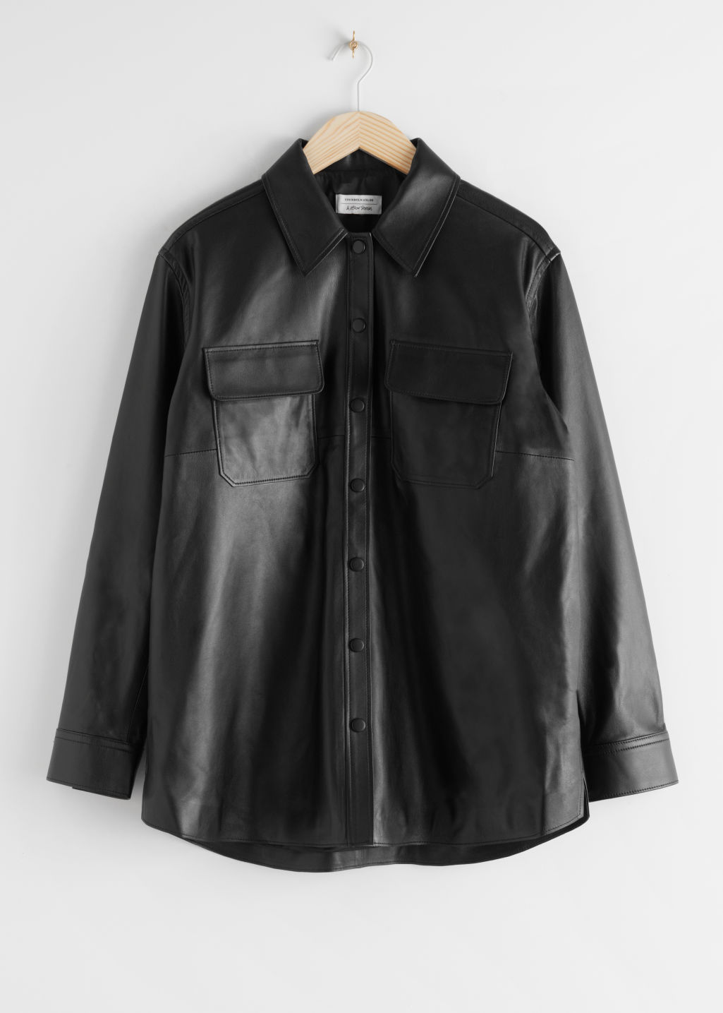Front image of Stories relaxed leather shirt in black