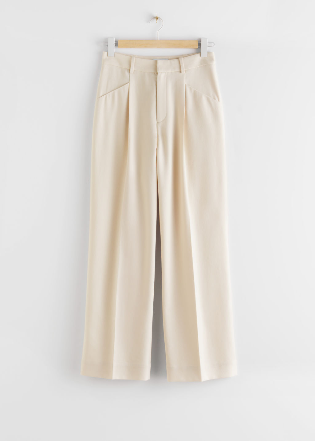 StillLife Front Image of Stories Duo Pleat High Rise Trousers in Beige