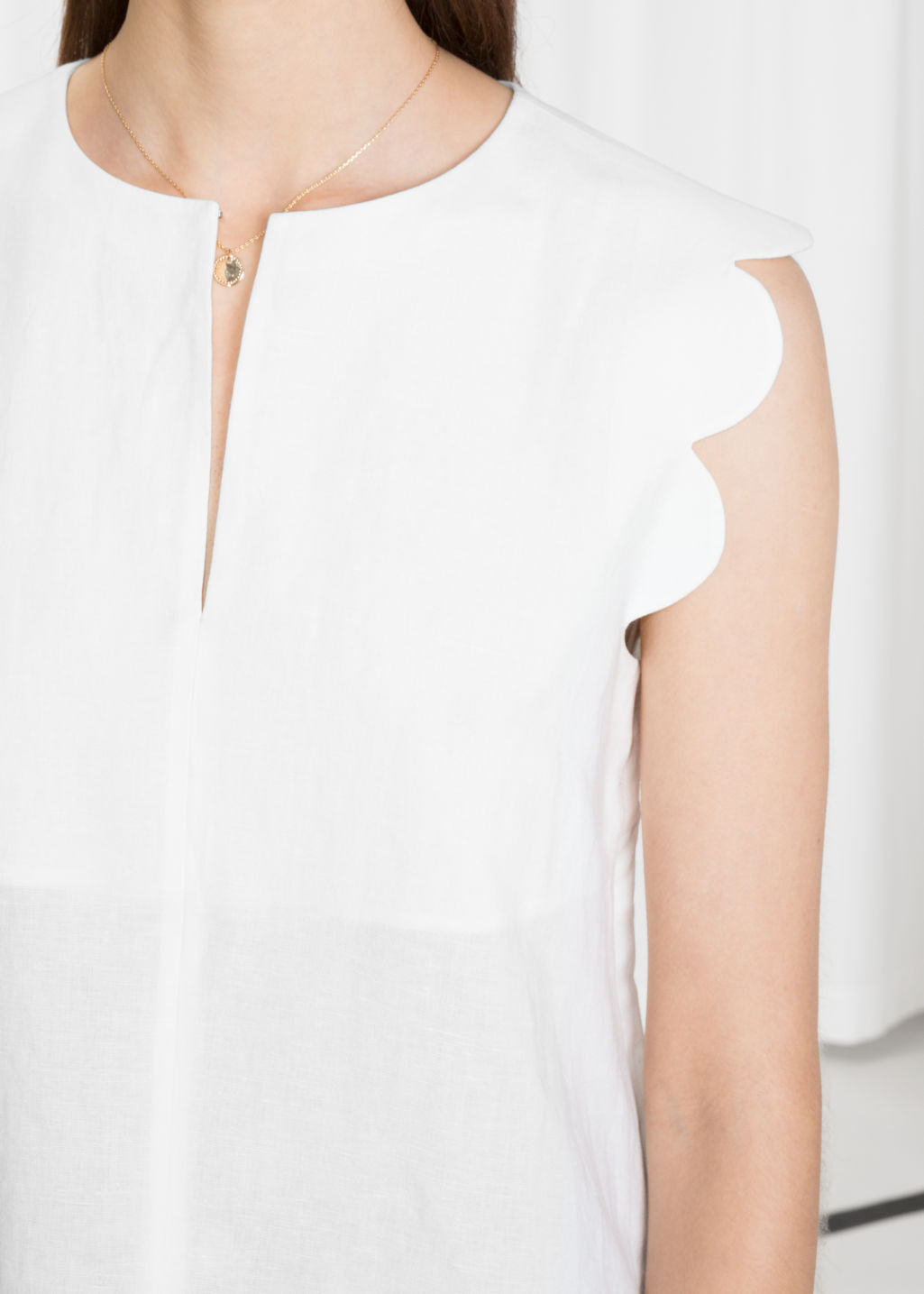 Detailed image of Stories scalloped blouse in white