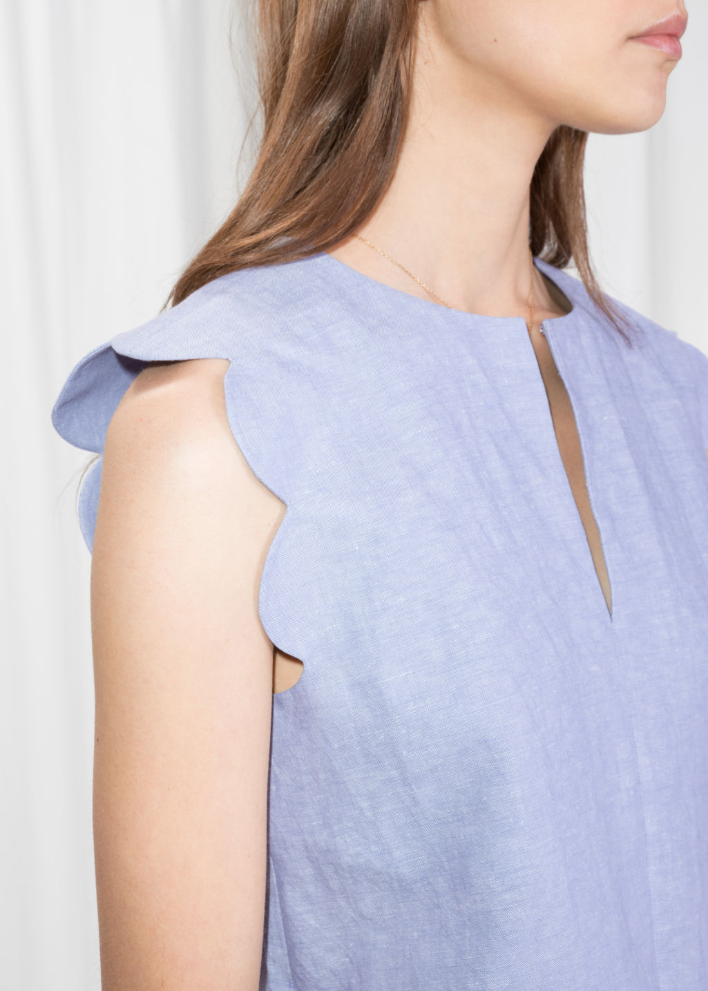 Detailed image of Stories scalloped blouse in blue