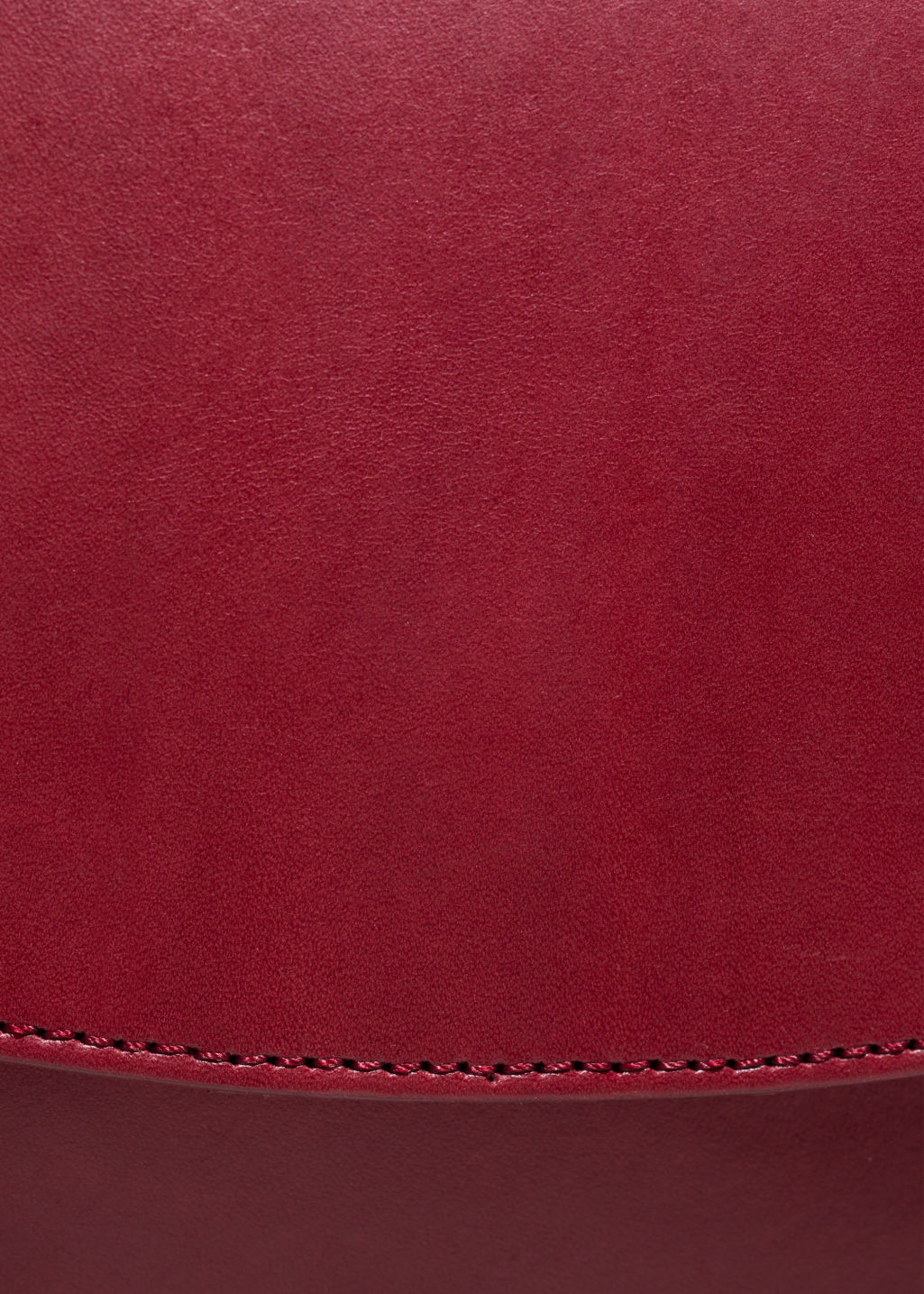 Detailed image of Stories saddle stitch leather shoulder bag in red