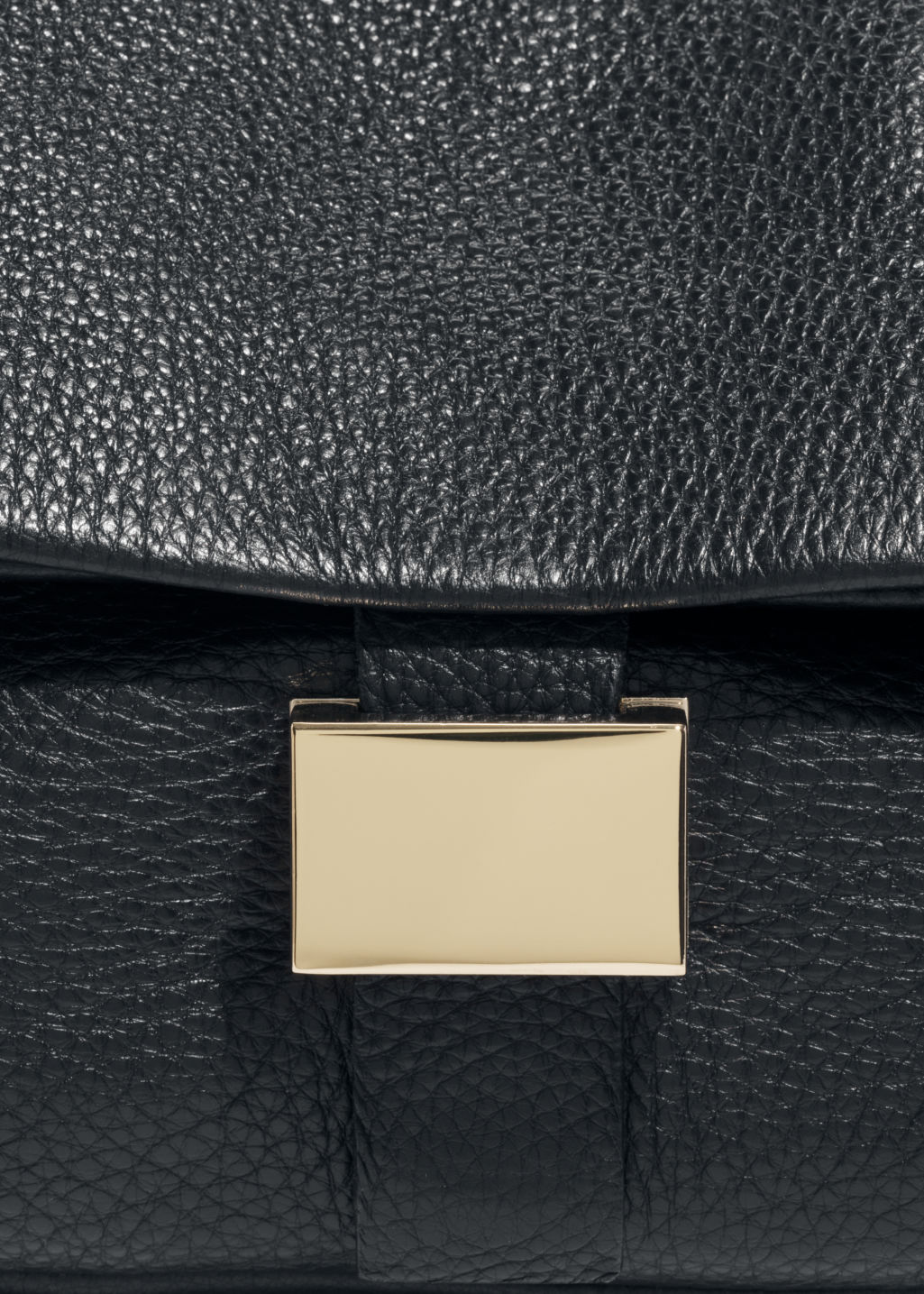 Detailed image of Stories small leather fold-over bag in black