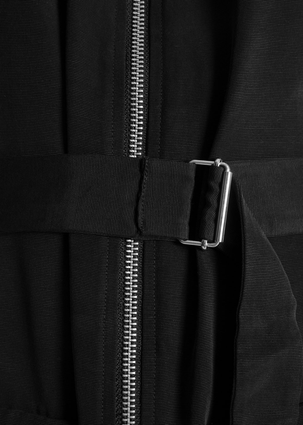Detailed image of Stories belted zip dress in black