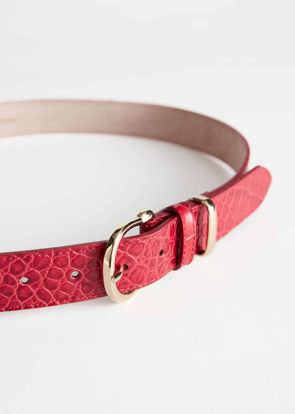 Detailed image of Stories croco leather belt in red