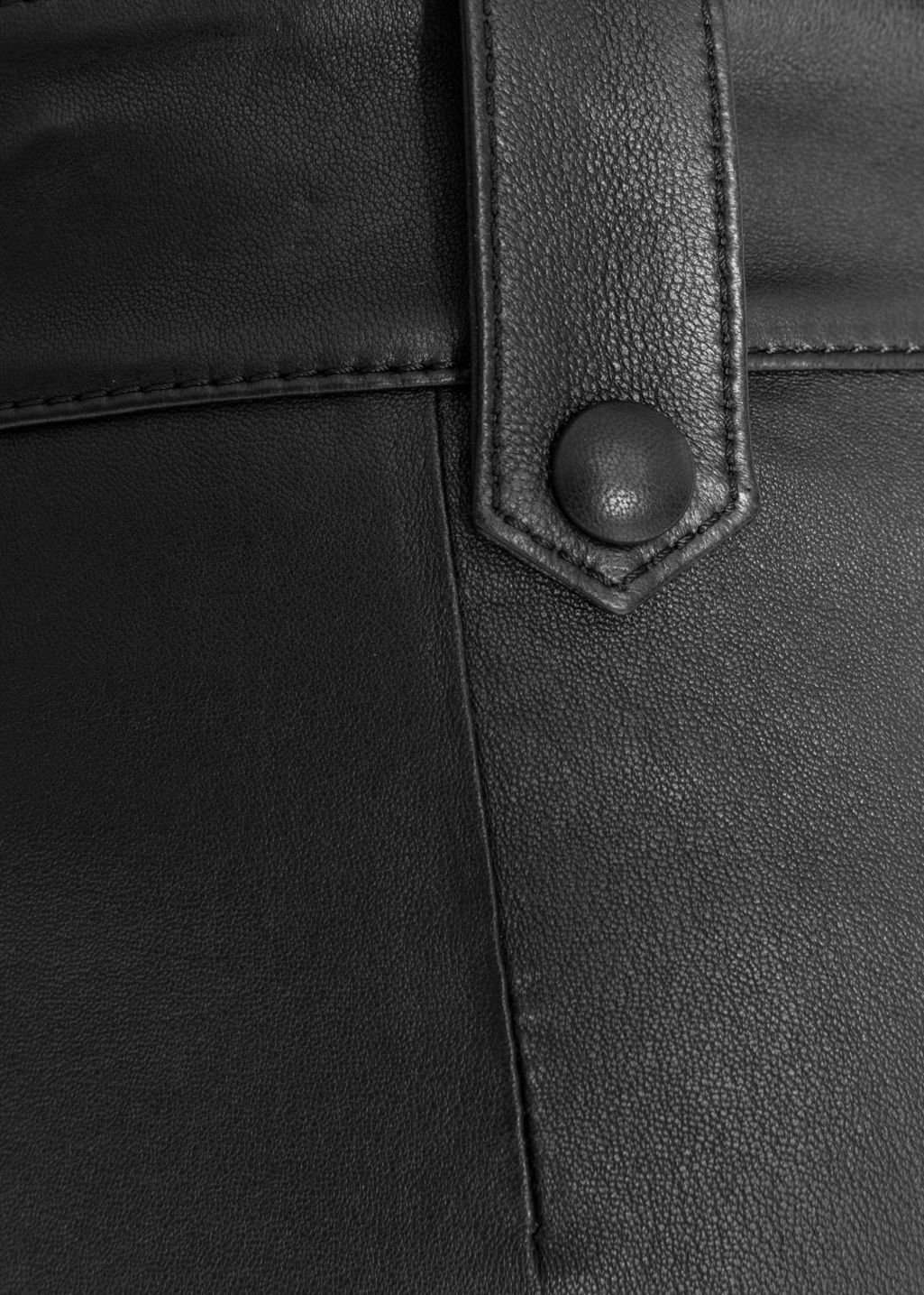 Detailed image of Stories leather trousers in black
