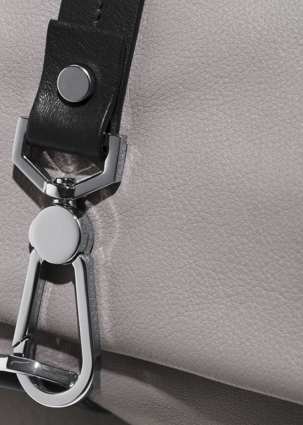 Detailed image of Stories soft leather buckle crossover in grey