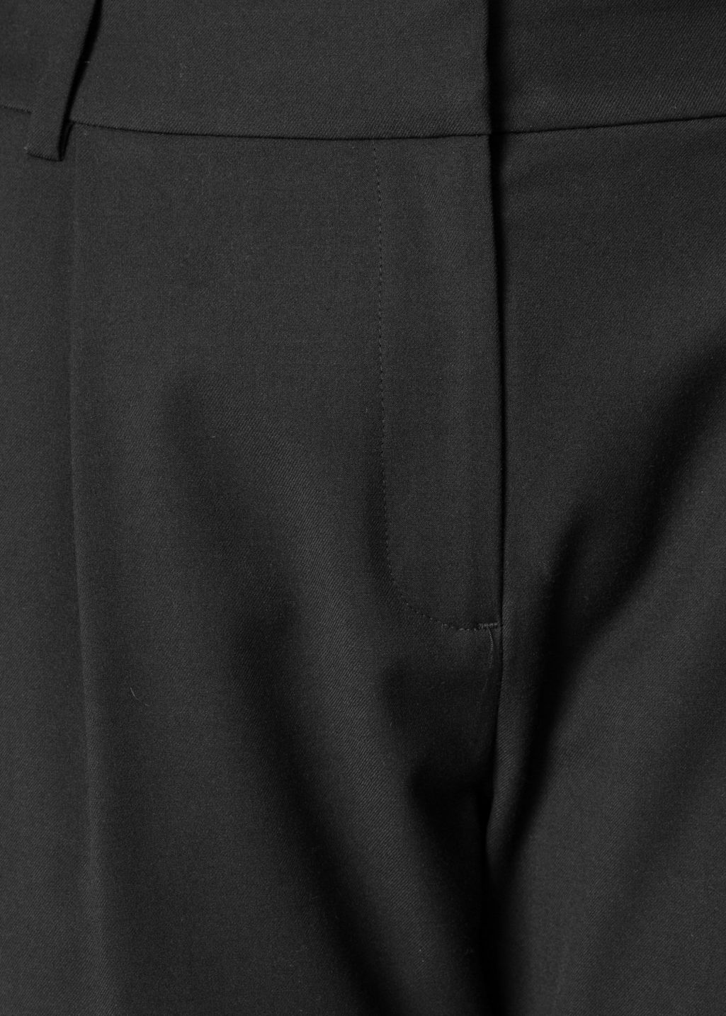 Detailed image of Stories tailored trousers in black