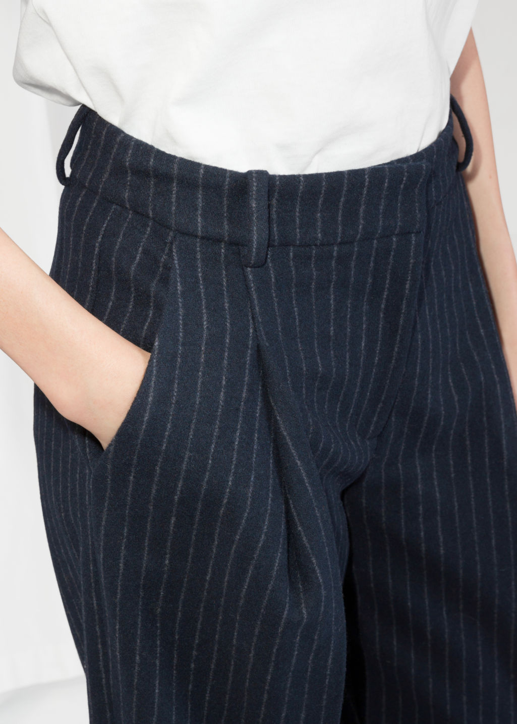 Detailed image of Stories pinstripe trousers in blue
