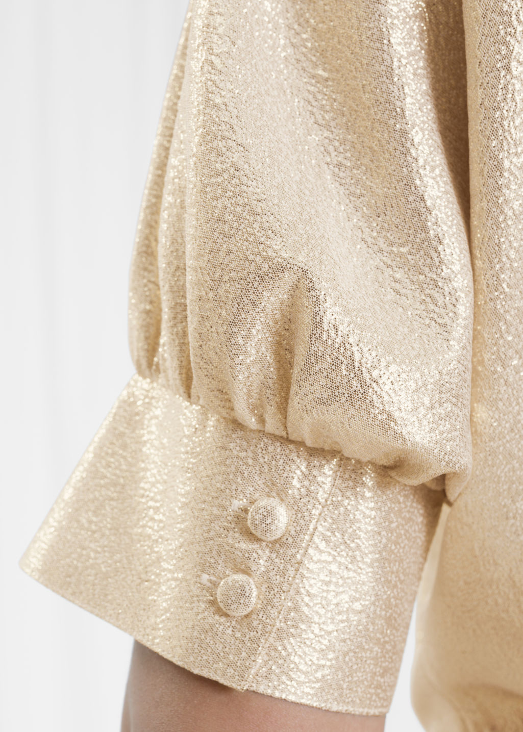 Detailed image of Stories metallic puff blouse in gold