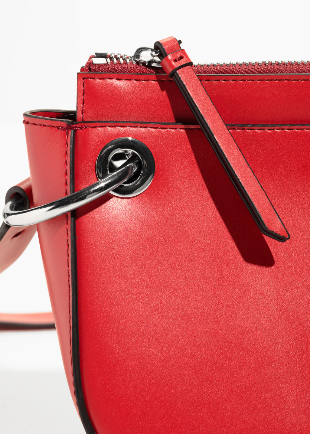 Detailed image of Stories mini leather saddle bag  in red