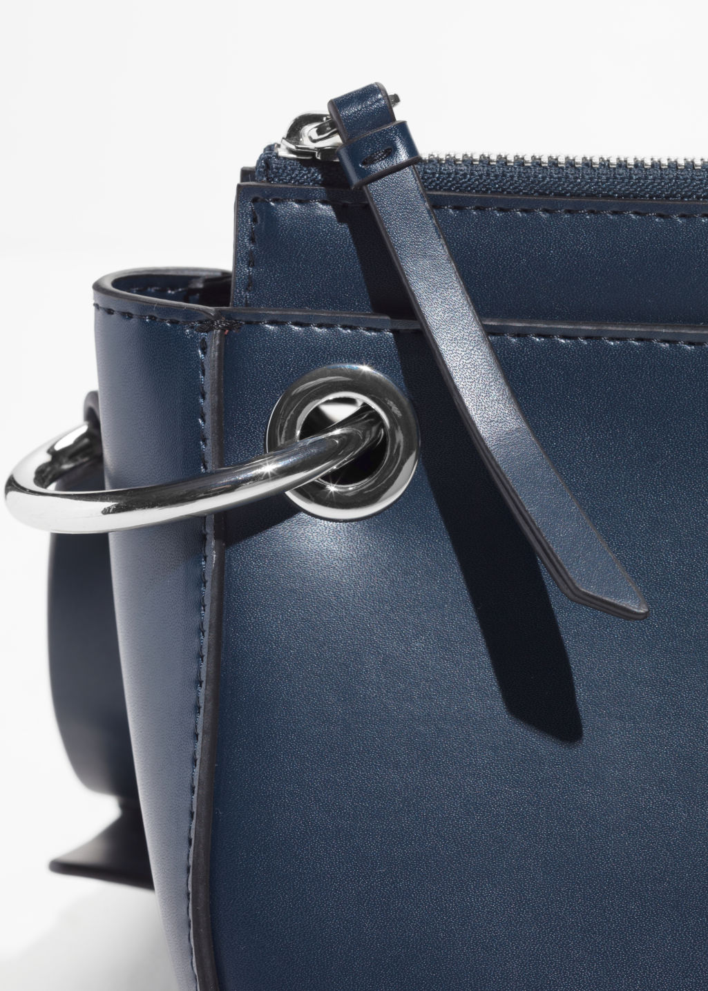 Detailed image of Stories mini leather saddle bag  in blue