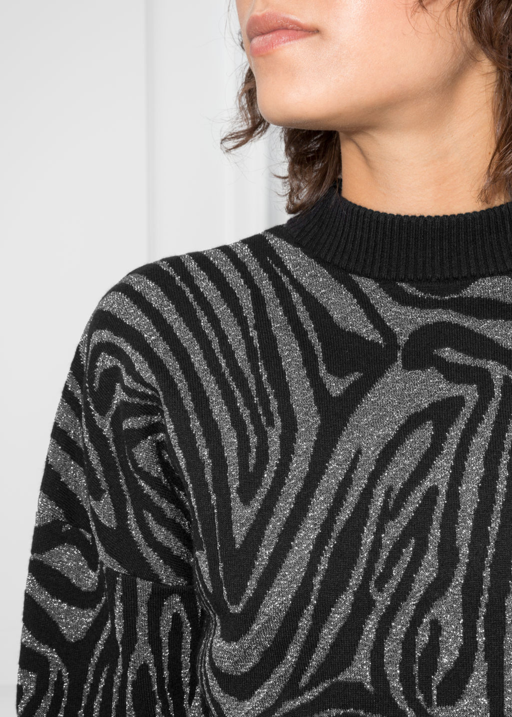 Detailed image of Stories jacquard zebra sweater  in black