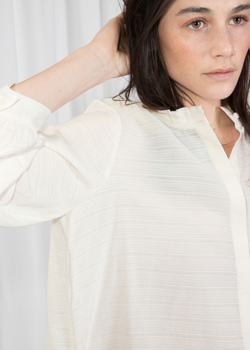 Detailed image of Stories relaxed ruffle collar blouse in white