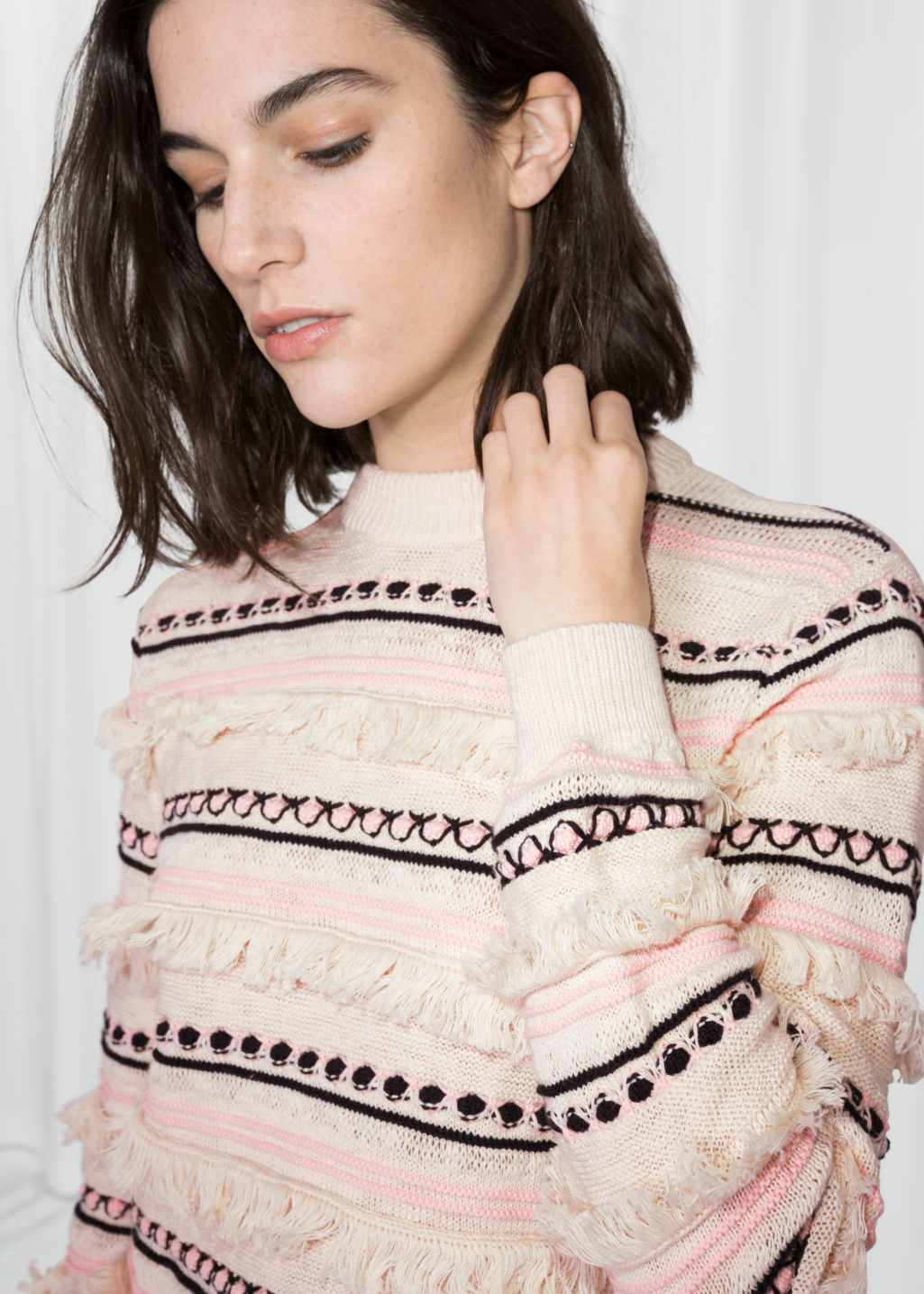 Detailed image of Stories striped fringe knit sweater in white