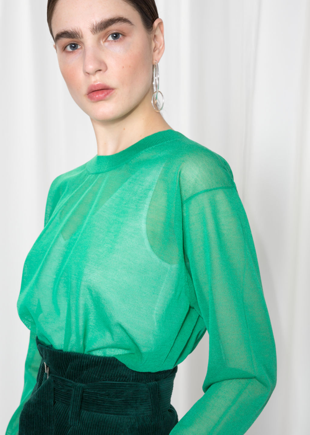 Detailed image of Stories sheer jumper  in green